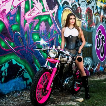 austin commercial photographer dustin meyer captures a brunette modeling on a motorcycle with grafitti walls
