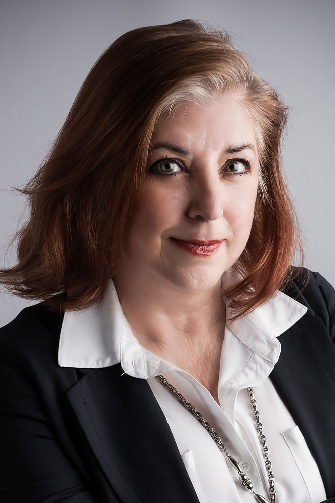professional headshots of a businesswoman in a suit